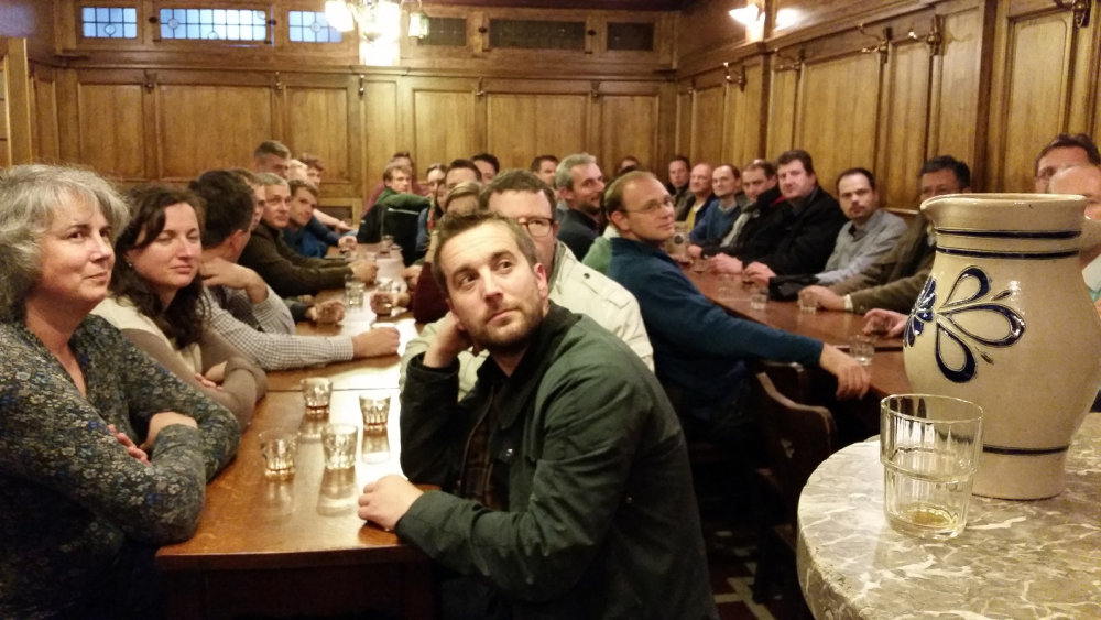 Everybody in full attention about how to taste a beer